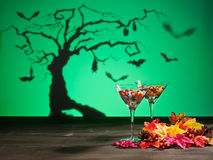 Sweets in Halloween setting with tree Royalty Free Stock Image