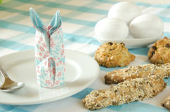 Sweets on the holiday table and eggs. Beautiful table setting Easter motive. Sweets on the holiday table, a cookie with a heart. Beautiful table setting easter Royalty Free Stock Photos