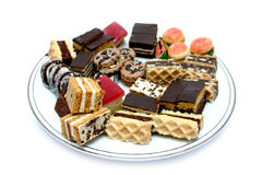 Sweets II. Various Sweets on Plate, isolated Royalty Free Stock Photos