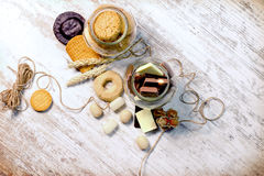 Sweets in jar on rustic table, pleasure for your senses Royalty Free Stock Image