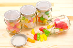 Sweets of jars and spilled jelly beans Royalty Free Stock Photography