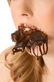 Sweets lover - mouth stuffed with chocolates Stock Photos