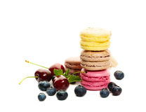 Sweets Macaroons with Blueberries and Cherries Royalty Free Stock Photos