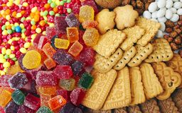 Sweets. Marmalade, crispy biscuits, chocolate shiver, peanuts in the glaze, the dream of a sweet tooth Royalty Free Stock Photos