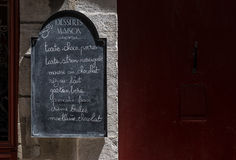 Sweets menu blackboard on a stone wall. Sweets menu blackboard on a stone wall in a street of France Stock Image