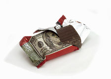 Sweets - money. Chocolate with the image of a dollar banknote on a candy wrapper Royalty Free Stock Photo