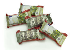 Sweets - money. Five Chocolate with image of dollar banknote on candy wrapper Stock Photo