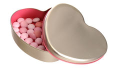 Sweets in an open silver heart shaped box. With pink inside Royalty Free Stock Images