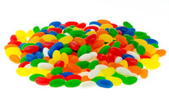 Sweets. Pile of colorful jellybean sweets on a isolated white background Stock Image