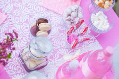 Sweets in pink. Biscuits and pink marshmallows on the table Royalty Free Stock Photography
