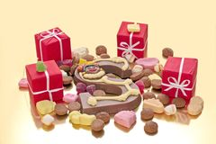Sweets and presents in December Royalty Free Stock Photos