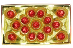 Sweets in red envelopment in gold box Stock Photos