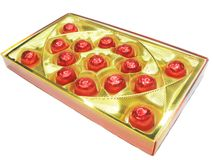 Sweets in red envelopment in gold box Royalty Free Stock Photography