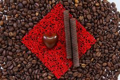 Sweets on the roasted coffee beans Royalty Free Stock Photo