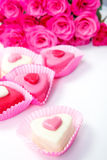 Sweets and roses Stock Photos