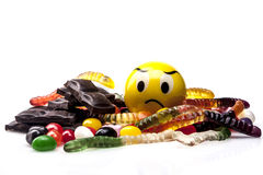 Sweets and Sad Emoticon Royalty Free Stock Photo