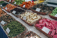 Sweets on sale. Different types of sweets, dried fruits and nuts on sale Stock Photos
