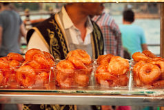 Sweets on showcase in street cafe of Istanbul - donuts in caramel Royalty Free Stock Photos