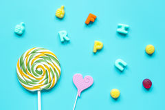 Sweets and sugar candies on blue background top view pattern Stock Image