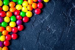 Sweets and sugar candies on dark background top view.  royalty free stock images