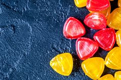 Sweets and sugar candies on dark background top view.  royalty free stock image