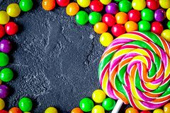Sweets and sugar candies on dark background top view.  royalty free stock photography