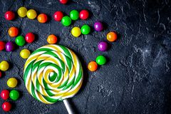 Sweets and sugar candies on dark background top view.  royalty free stock photo