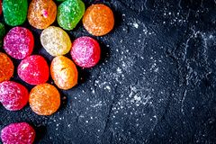 Sweets and sugar candies on dark background top view.  stock images
