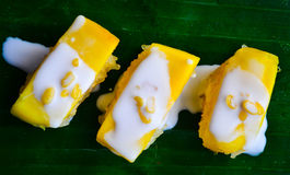 Sweets. Sweet mango with on stick rice Royalty Free Stock Photo