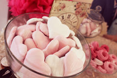 Sweets on table, with clock and vintage design Royalty Free Stock Image