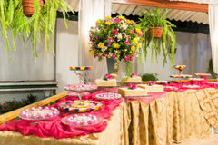 Sweets table and flower arrangement Stock Photos