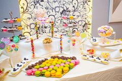 Sweets table at a party. Colored sweets on a table during a party Stock Images