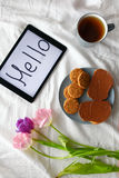 Sweets,tablet and tulips.  Women`s day, Mother`s Day. Stock Photography