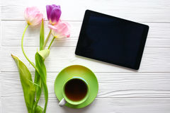 Sweets,tablet and tulips.  Women`s day, Mother`s Day. Royalty Free Stock Images
