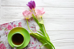 Sweets,tablet and tulips.  Women`s day, Mother`s Day. Royalty Free Stock Photo