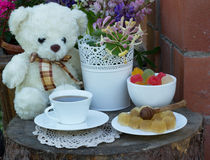 Sweets with tea and flowers Royalty Free Stock Photos