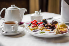 Sweets and tea by ZVEREVA Stock Photos