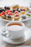 Sweets and tea by ZVEREVA Royalty Free Stock Photography