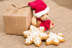 Sweets and toys to children for Christmas Stock Photo
