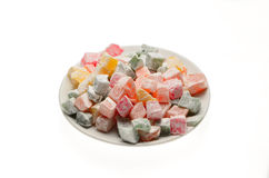 Sweets Turkish Delight, fruit jelly in coconut chips color on a Stock Images