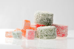 Sweets Turkish Delight, fruit jelly in coconut chips color on a Royalty Free Stock Photography