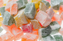 Sweets Turkish Delight, fruit jelly in coconut chips color on a. White background Stock Photo