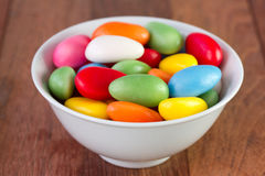 Sweets in white bowl on dark background Royalty Free Stock Image