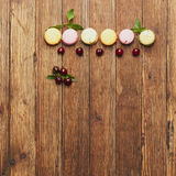Sweets on wooden background Royalty Free Stock Images