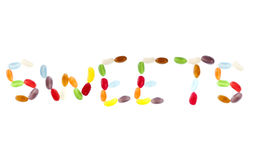 Sweets written with jelly beans Royalty Free Stock Photo
