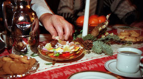 Sweets at xmas. Hand taking sweets at coffee table with christmas decorations royalty free stock image