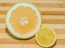 Sweety fruit and lemon Stock Photos
