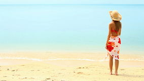 Sweety wearing pareo and bikini at tropical beach Royalty Free Stock Images