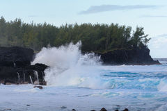 Swell rolling over volcanic rocks at Reunion Island Royalty Free Stock Photo