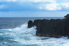 Swell rolling over volcanic rocks at Reunion Island Royalty Free Stock Image